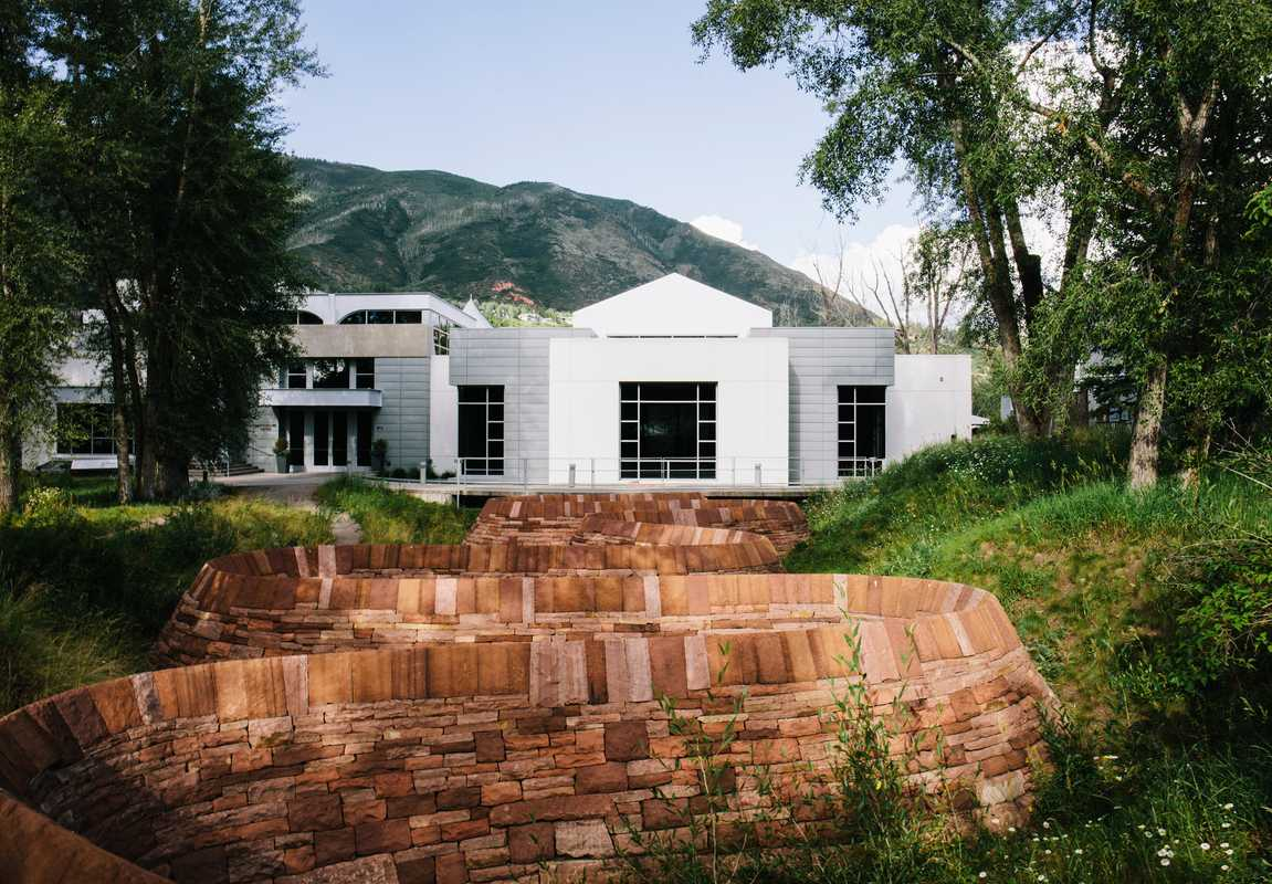 Andy Goldsworthy's 'Stone River' artwork in front of the Doerr-Hosier Center