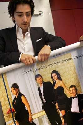 A poster for the series As¸k-ı Memnu in the Kanal D sales and acquisitions office