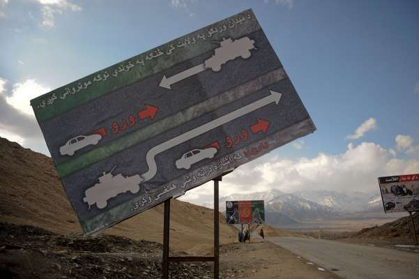 ISAF billboards warning civilians to keep back from military convoys on Highway One (the most dangerous road in Afghanistan) heading south from Maidan Shah, Wardak province