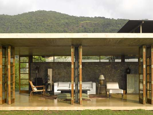 The large living room opens out onto the landscape