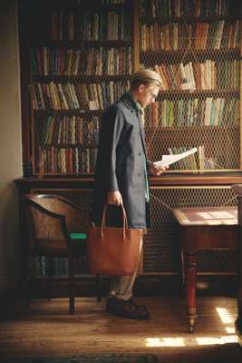 Coat by Mackintosh for Beams,scarf and trousers by Brunello Cucinelli,glasses by Oliver Peoples, shoes and bag by Visvim