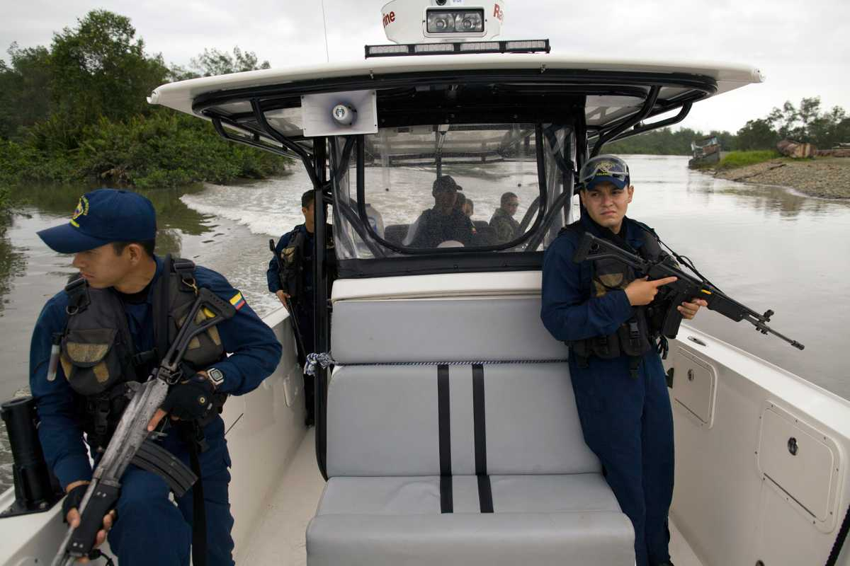 The Navy and coast guard patrol waters around the port in search of traffickers