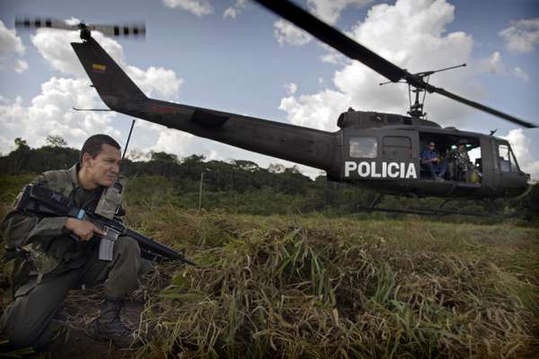 A helicopter lands in territory controlled by the guerilla group Farc