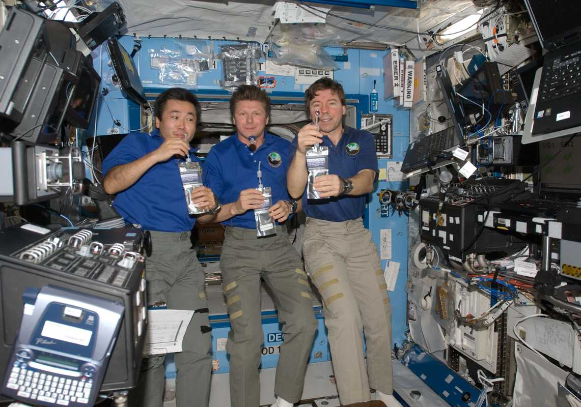Wakata with fellow astronauts aboard the International Space Station
