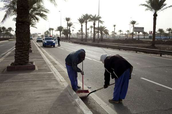 Workers at Baghdad Airport Road