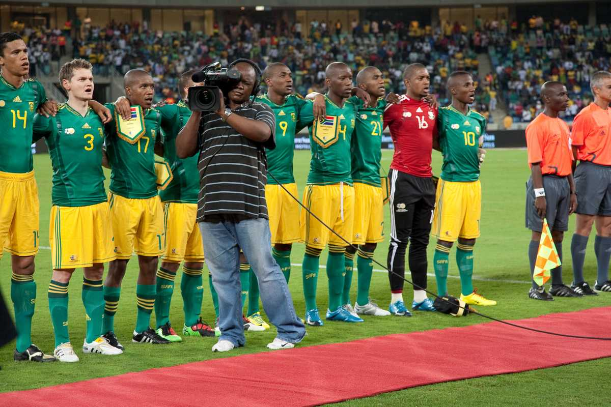 An SABC cameraman films during the South African national anthem at the Moses Mabhida stadium