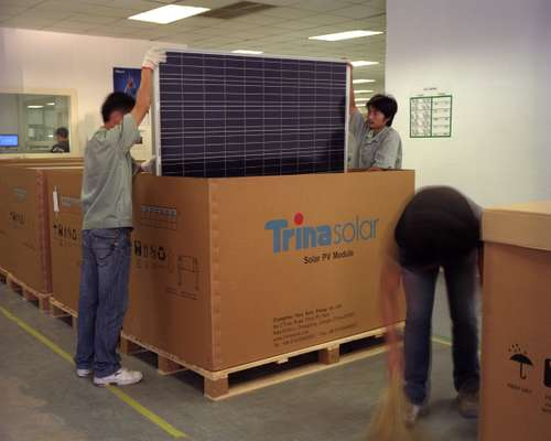 Packing solar panels for shipment at Trina Solar