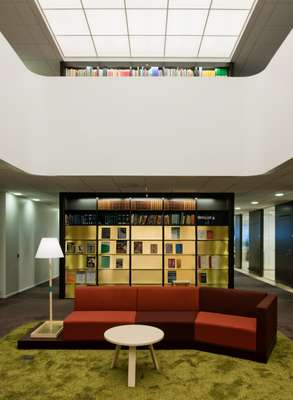 The library, featuring a back-lit glass ceiling and bespoke furniture by Martin-Löf