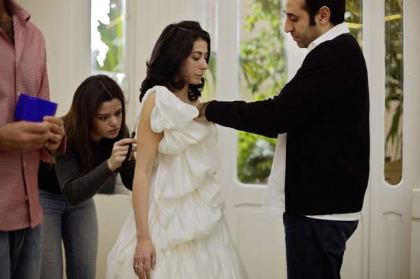 Fashion designer Rabih Keyrouz working on a client's wedding dress