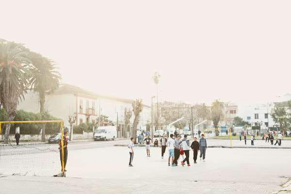 Children playing football in Marshan