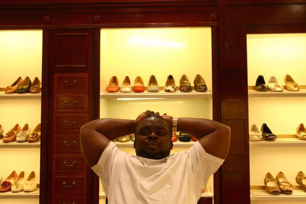 Reuben, from Liberia, checks out the latest stock of luxury shoes