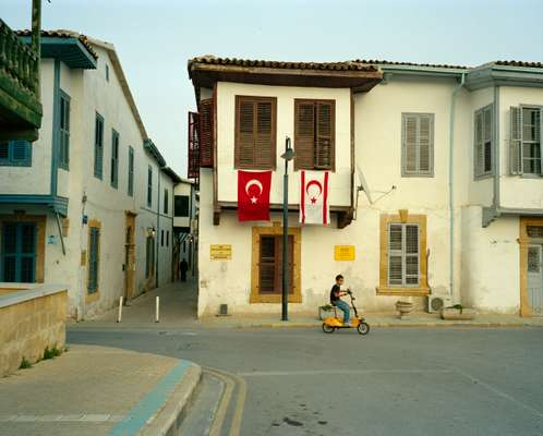 Turkish flag flies next to a TRNC one in Nicosia