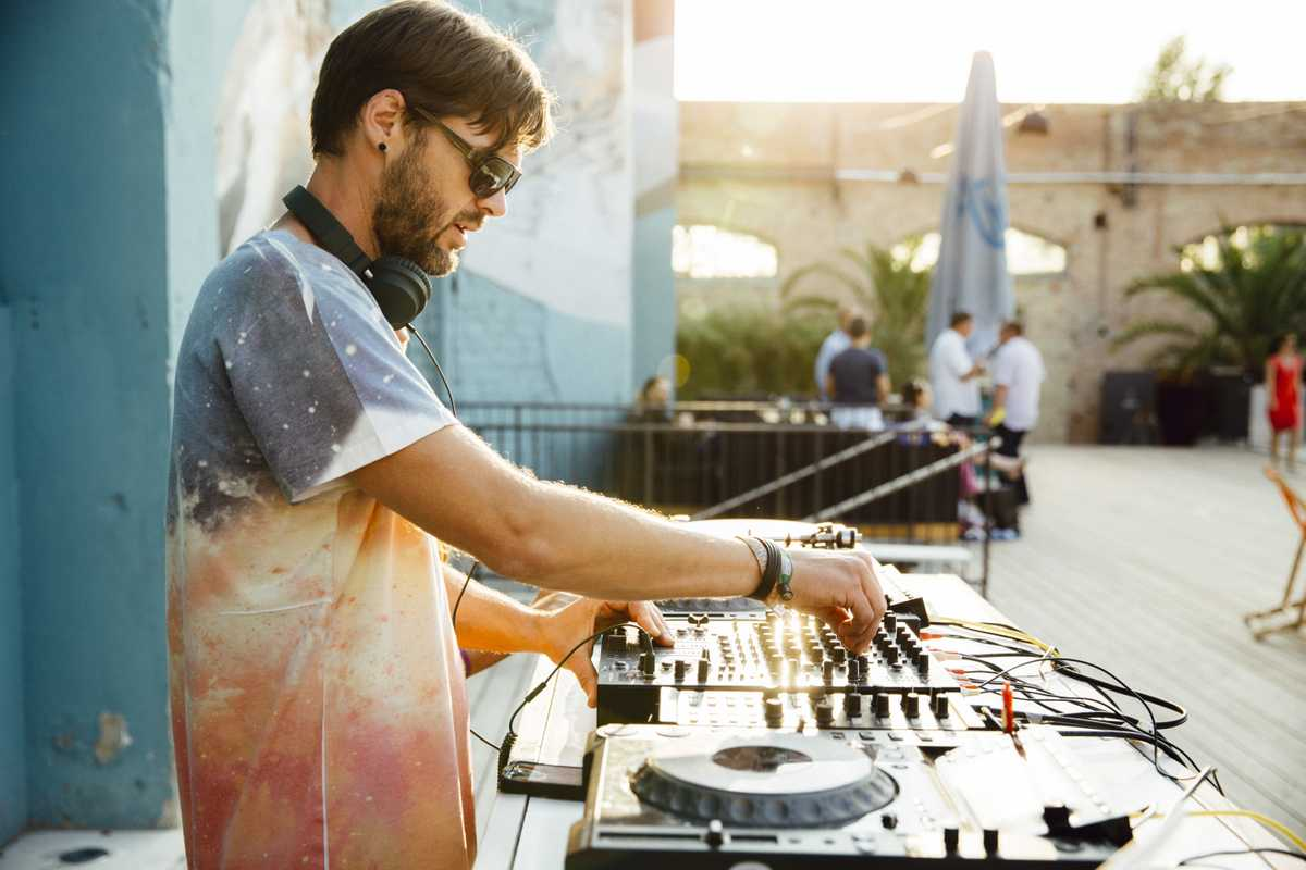 As the sun goes down, a DJ turns it up