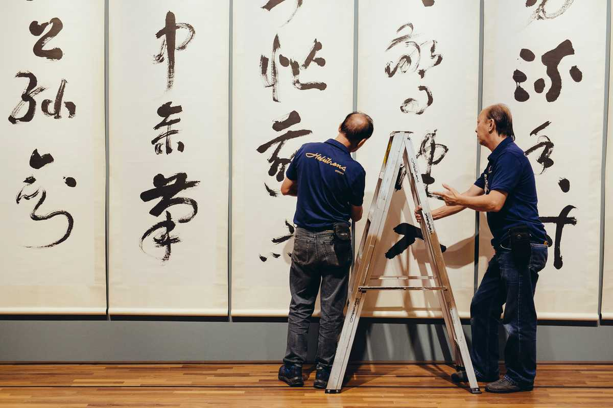 Technicians aligning the painting
