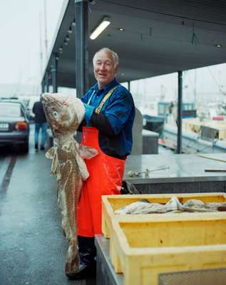 Fisherman Carl August Arge sells his weighty catch in Tórshavn harbour