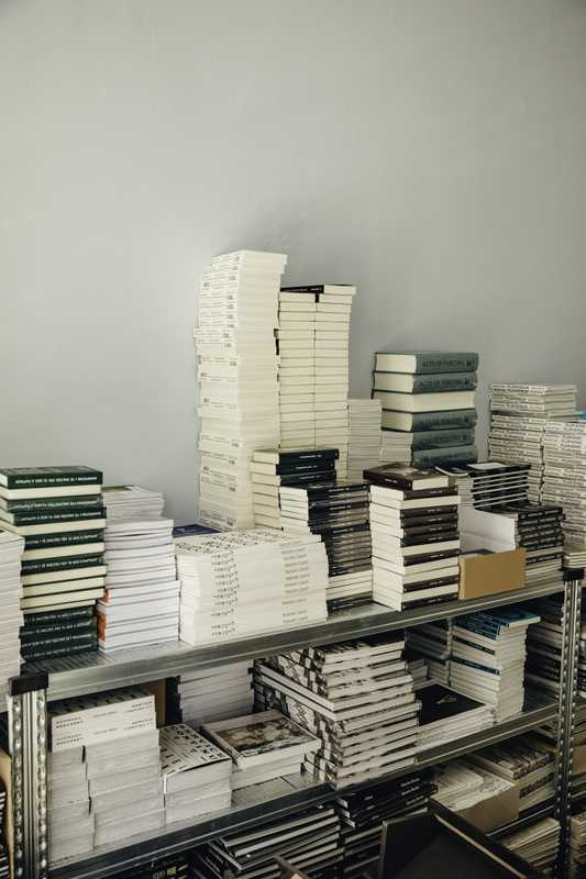 Racks piled high with publications at Spector Books' office