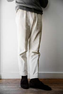 The label's pleated trousers