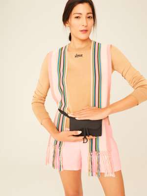 jumper by Loewe, shorts by Akris, waist pouch by Dior