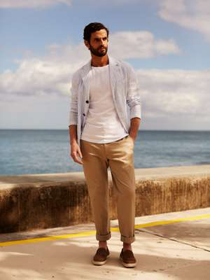 Jacket by Barena Venezia,  t-shirt by Ron Dorff, trousers by Brioni, slip-ons by Tod's