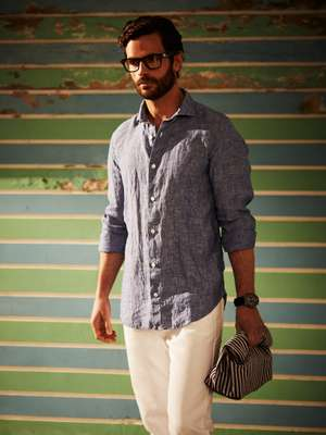 Shirt and jeans by Eleventy, glasses by Oliver Peoples, watch by Victorinox, bag by Steve Mono