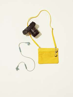 Bag by Arket, camera by Leica, earphones by Bang & Olufsen