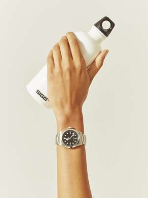 Watch by Tudor, water bottle by Sigg
