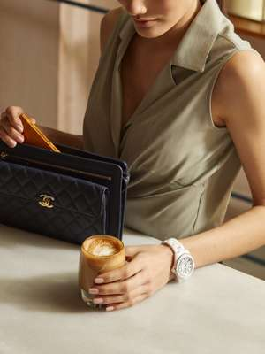 Blouse by Giuliva Heritage Collection, bag and watch by Chanel, card case by Ettinger