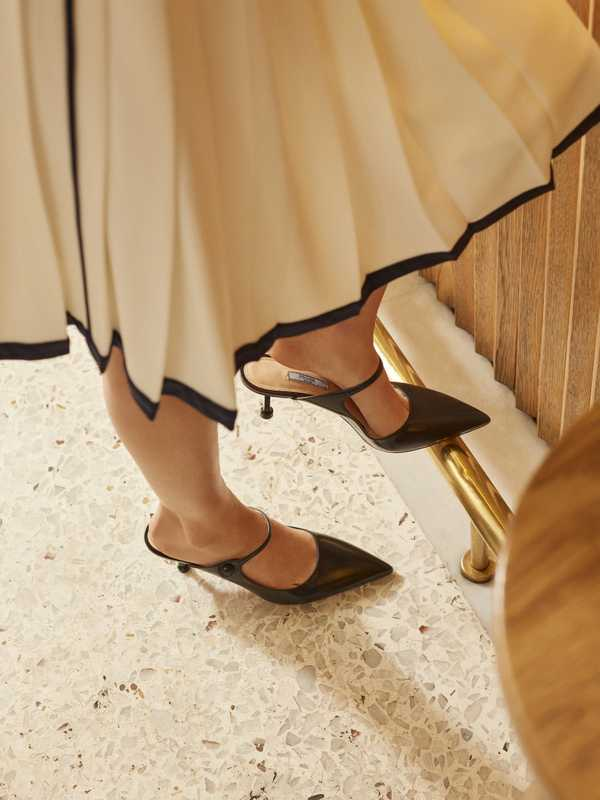 Skirt and mules by Prada