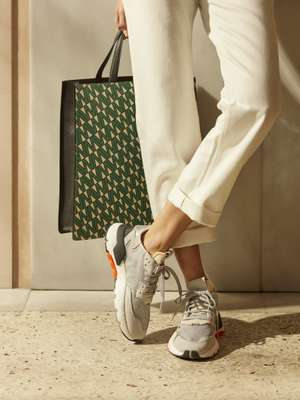 Jeans by Acne Studios, trainers by Adidas, bag by Valextra