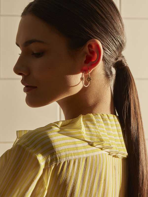 Blouse by Chanel, earrings by Dior