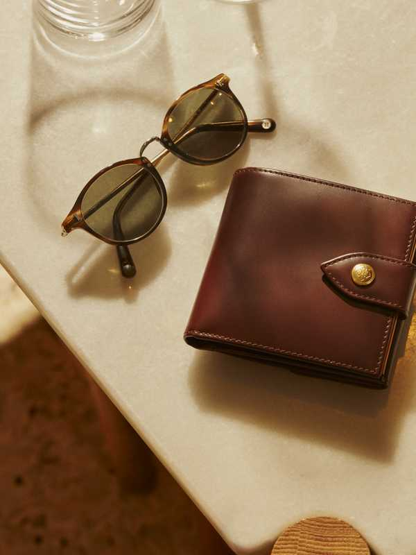 Sunglasses by Cubitts, wallet by Ettinger