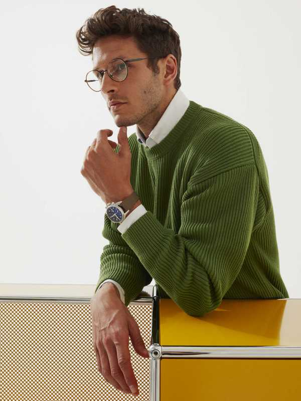 Jumper by Auralee, shirt by Hackett London, glasses by Giorgio Armani, watch by IWC Schaffhausen