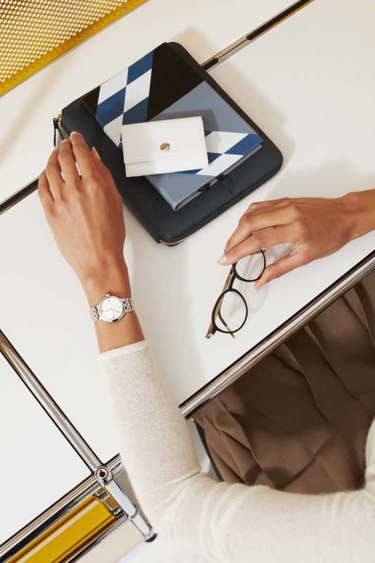Jumper by Auralee, watch by Tudor, glasses by Lindberg, diaries by Smythson, coin purse by Ettinger