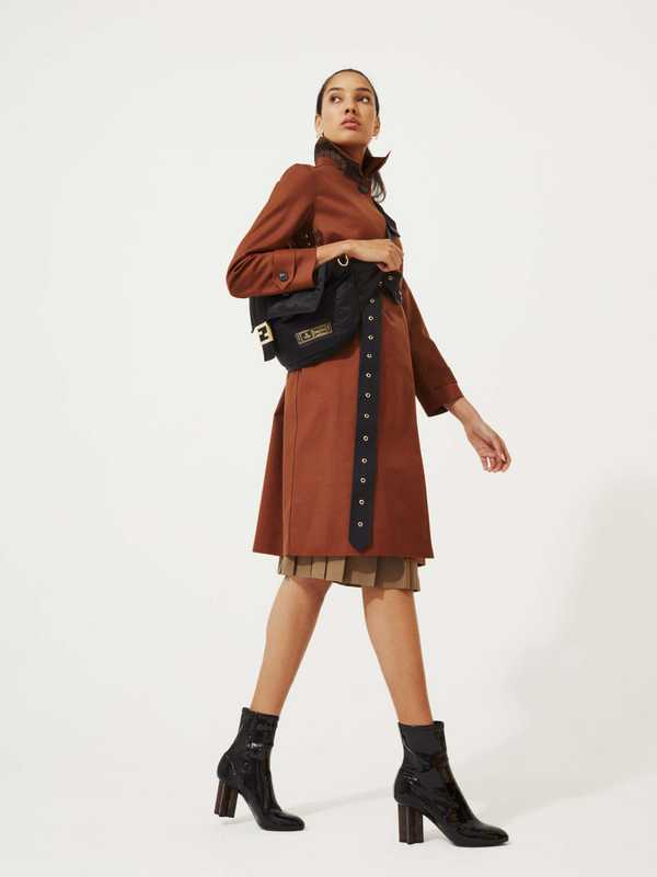 Coat by Mackintosh, skirt by Sunspel, boots by Louis Vuitton, earrings by Ana Khouri, bag by Fendi and Porter