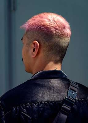 "Chai: ""It's shaved on the side and I leave some volume on top. The pink's a thing for people who want emphasis."""