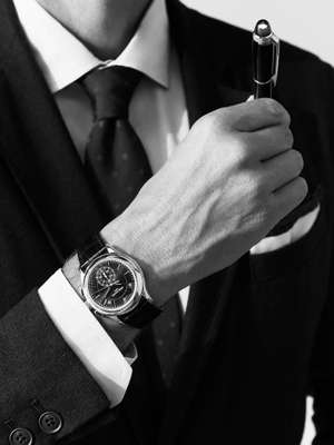 JACKET AND SHIRT BY Brooksfield, TIE by Drake's, POCKET SQUARE by Timothy Everest, 5905P WATCH by Patek  Philippe, STARWALKER BLACK RESIN PEN by Montblanc