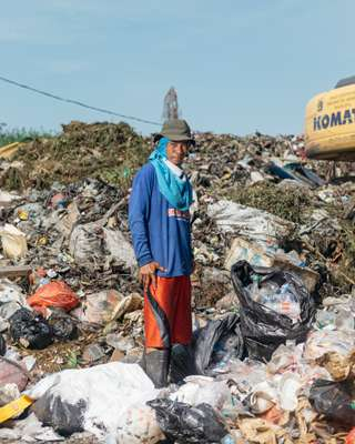 Scavenging at a temporary rubbish dump in Puit, north Jakarta