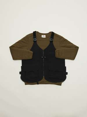 'Takibi' vest worn over flexible insulated pullover