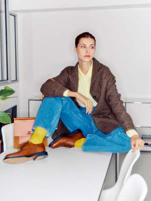 JACKET by Massimo Alba, POLO SHIRT by Tricot Paris, JEANS by Crista Seya, SOCKS by Maria La Rosa, SHOES by JM Weston, BAG by Hermès, RING by Objet Singulier