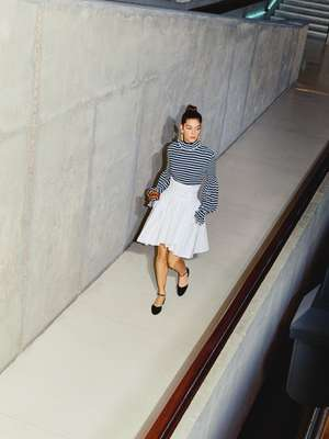 Rollneck jumper, skirt and shoes by Chanel, earrings by Celine,  bangles by Saint Laurent