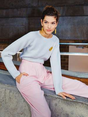 Jumper by Margaret Howell, trousers and brooch by Patou, earrings by Celine