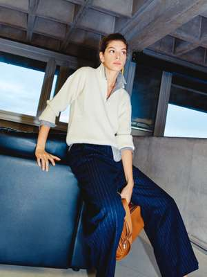 Jumper by CristaSeya, shirt and earrings by Celine, trousers by Patou, bag by Hermès