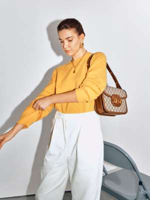 Jumper and trousers by YMC, earrings and necklace by Moya, bag by Gucci