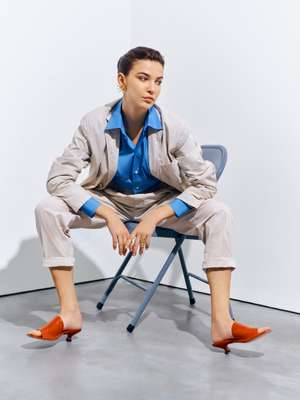 Jacket and  trousers by The Gigi, shirt, earring and ring by Dior, sandals by Tod's