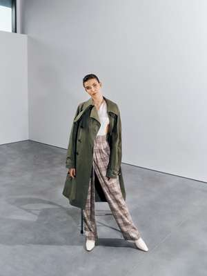 Coat by Sealup, bodysuit and trousers by Agnona, shoes by Bally, earrings by Tiffany & Co