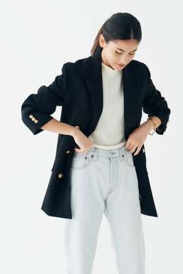 Jacket by Union Launch, highneck jumper by Molli, jeans by Acne Studios, bracelet by Tiffany & Co
