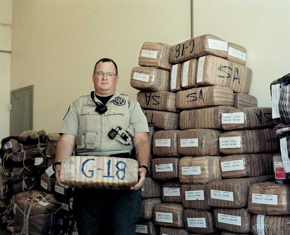Deputy Sheriff Tim Barrett with marijuana seized from smugglers