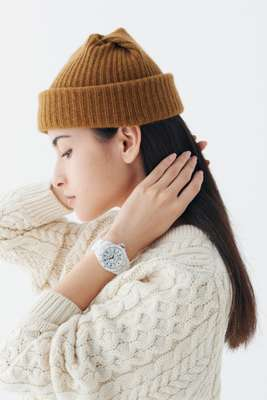 Jumper by Sunspel, beanie by Mature Ha, watch by Chanel bottom