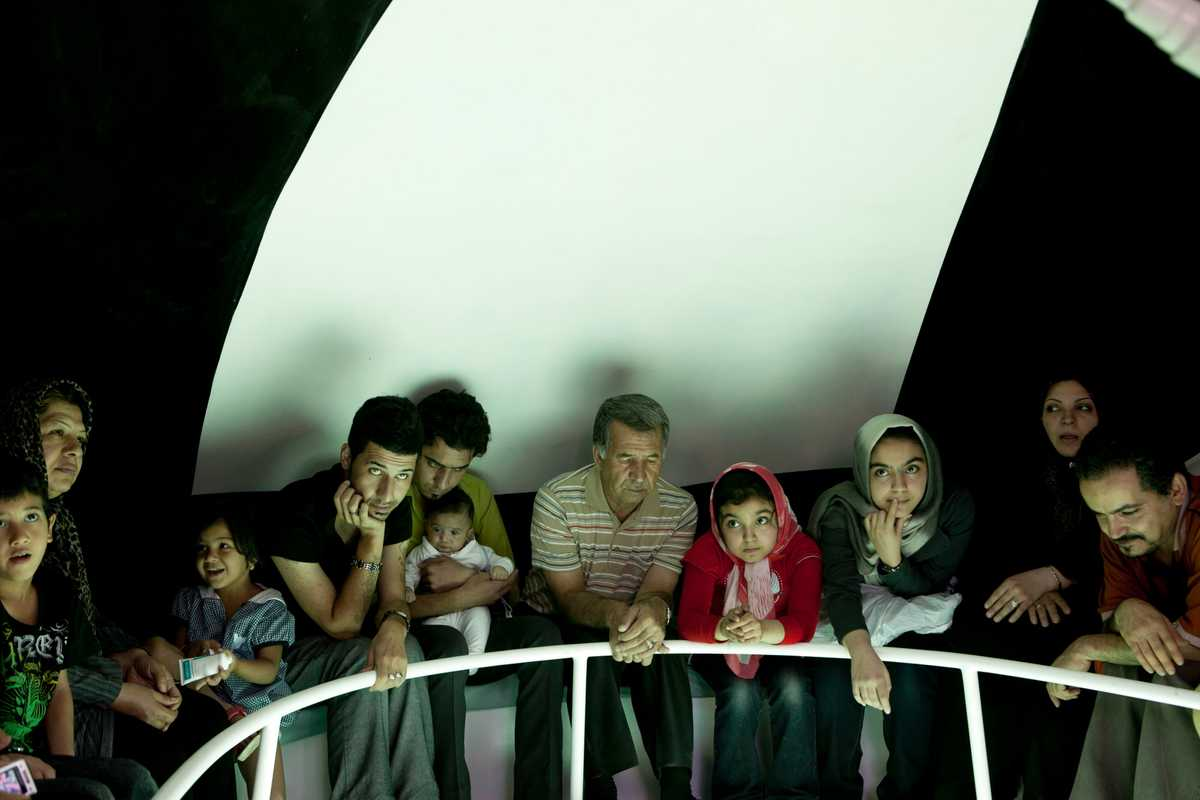 Family from the landlocked city of Mashhad take a trip in a glass-bottomed boat.