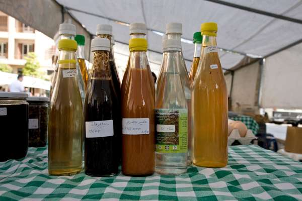 Massoud's homemade flower extract, pomegranate and grape syrups at Souk el Tayeb market